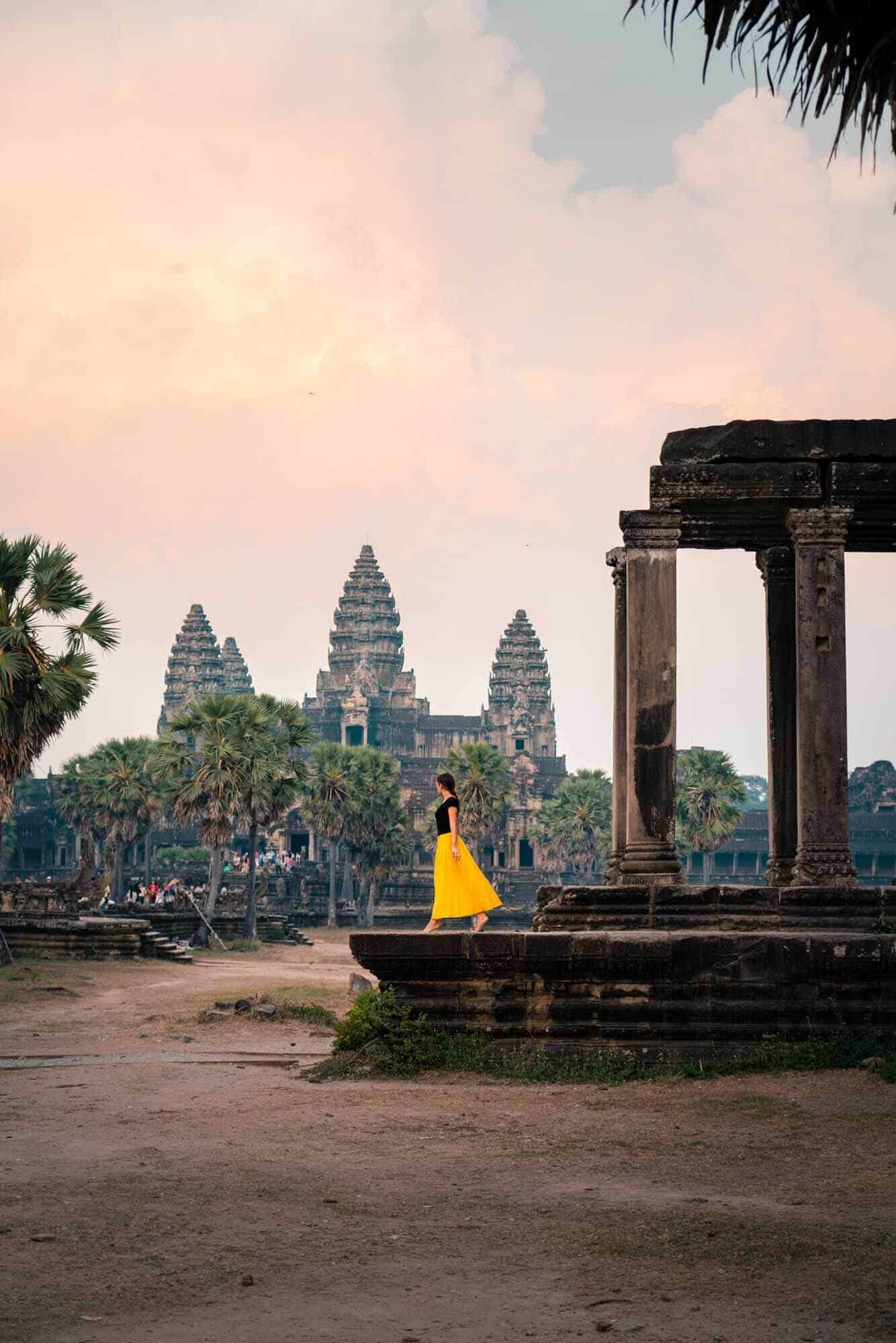 Angkor Wat Temple at sunset featuring @TravelsofSophie in a bright yellow dress