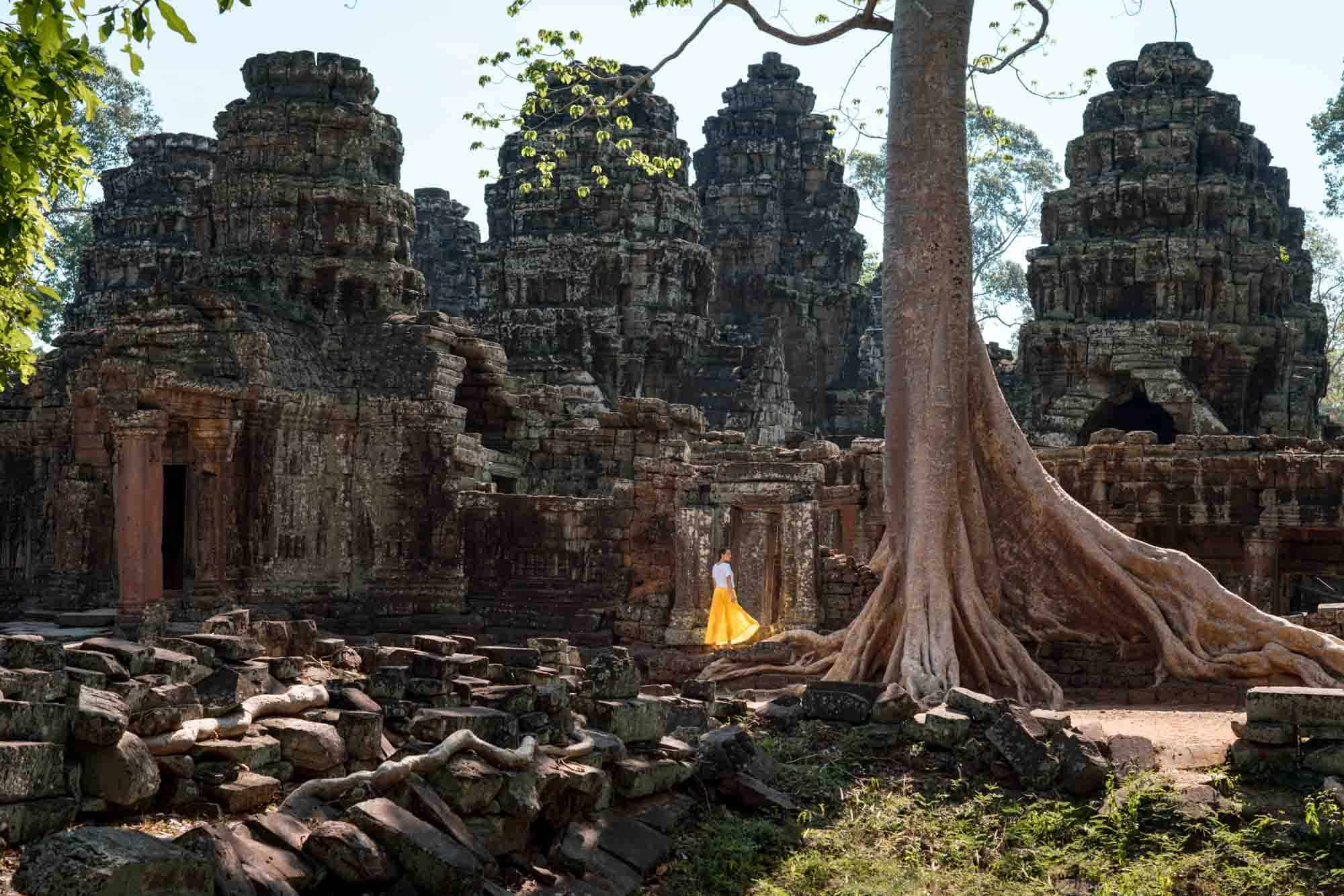 Banteay Kdei Temple with Sophie in a yellow dress