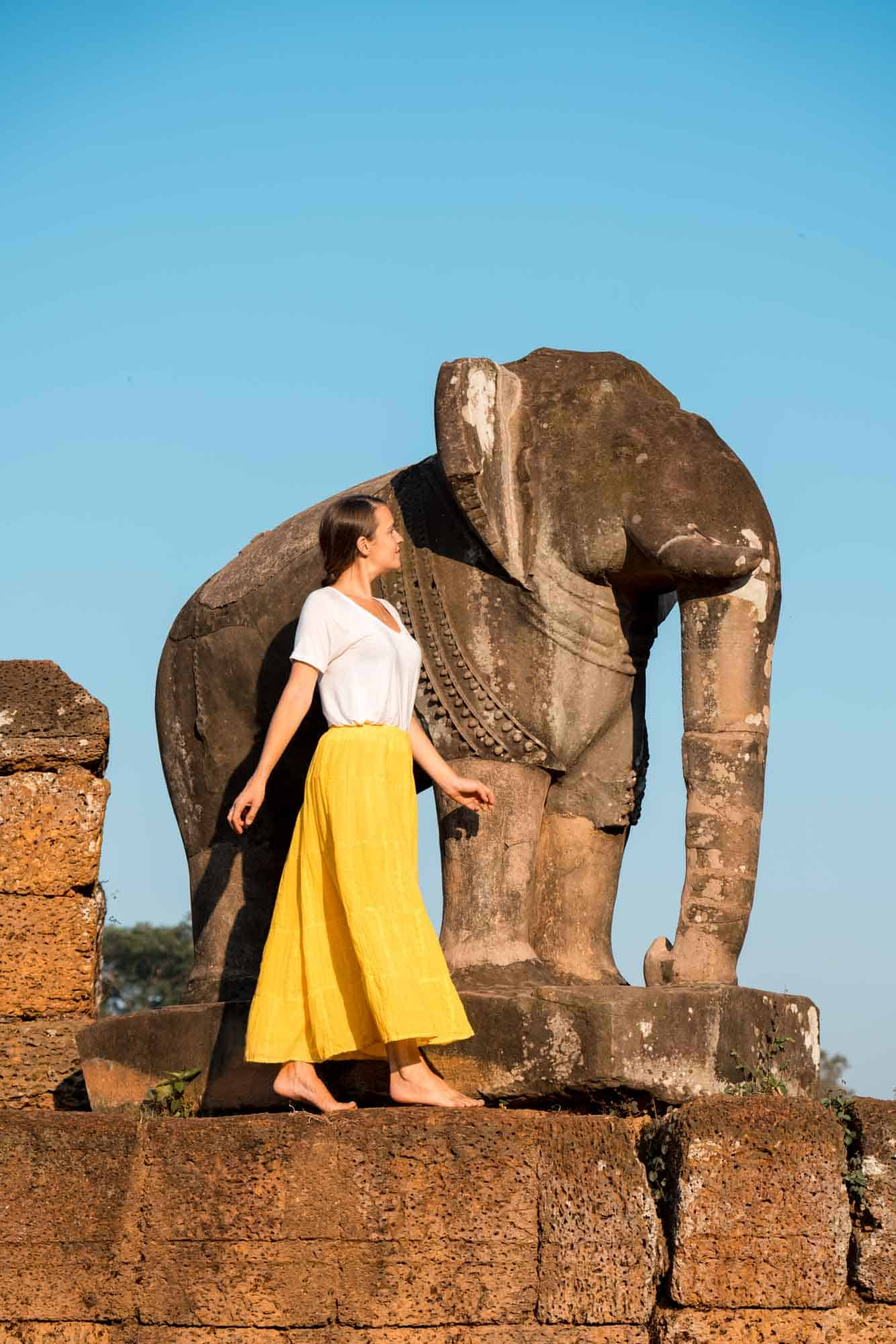 7:10am - Golden light on the elephants of East Mebon
