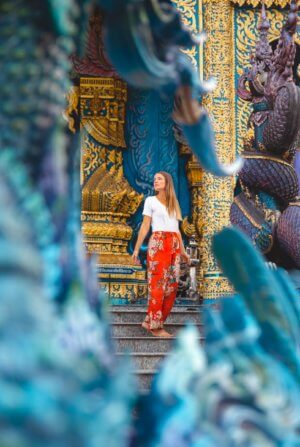 Travels of Sophie pausing for a photo at the Blue Temple in Chiang Rai, Thailand.