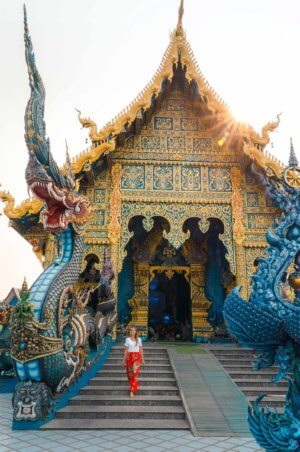 Sun set at the entrance to the Blue Temple in Chiang Rai, Thailand.