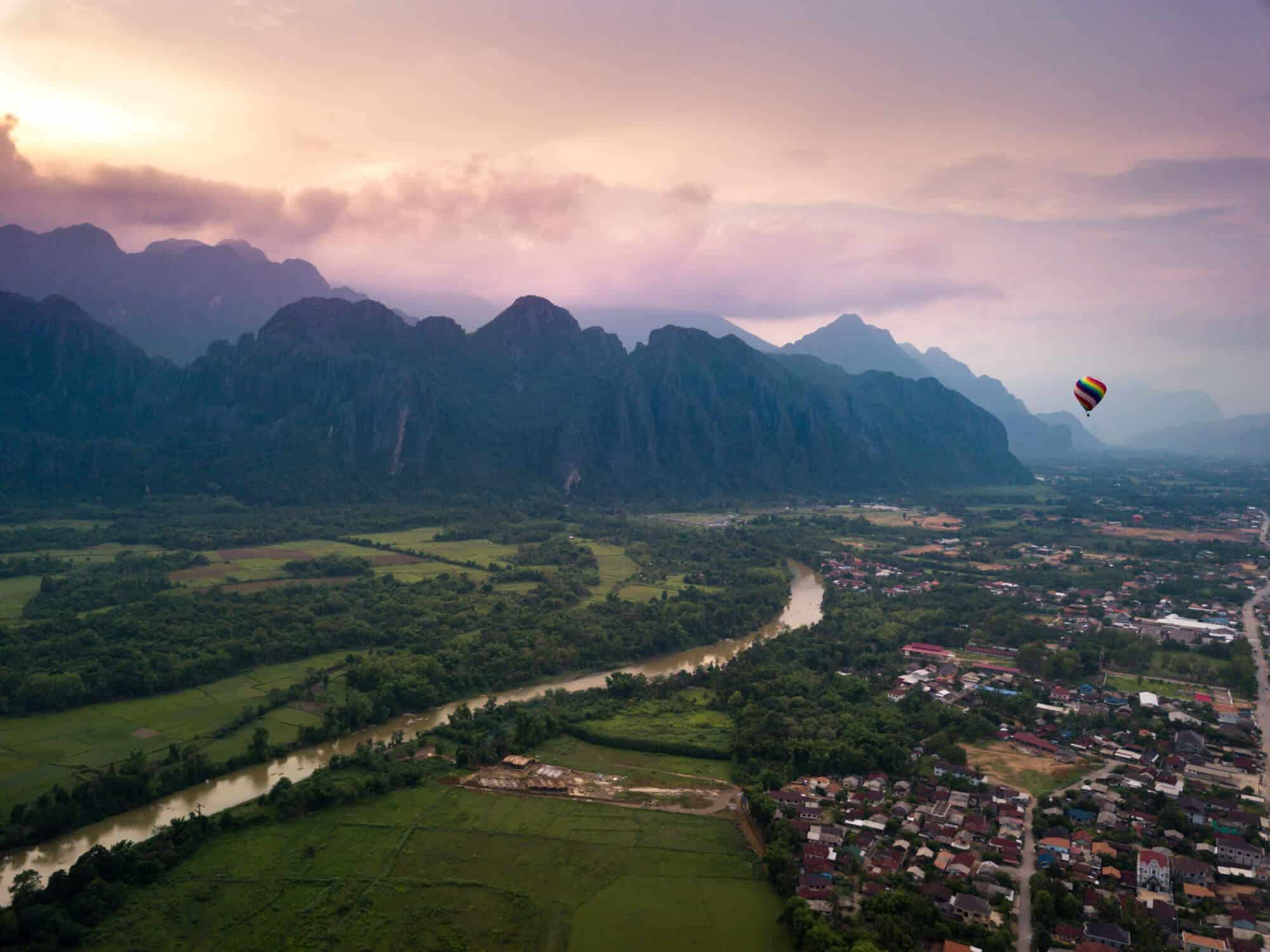 A hot air balloon ride through the mountains of Vang Vieng during sunset