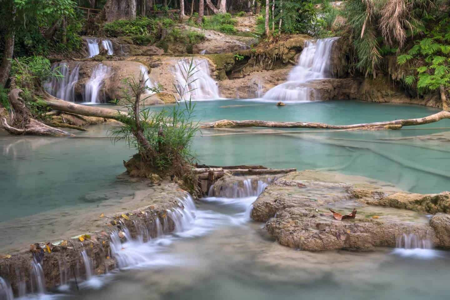 A beautiful landscape photograph of the first pools of Kuang Si Falls.