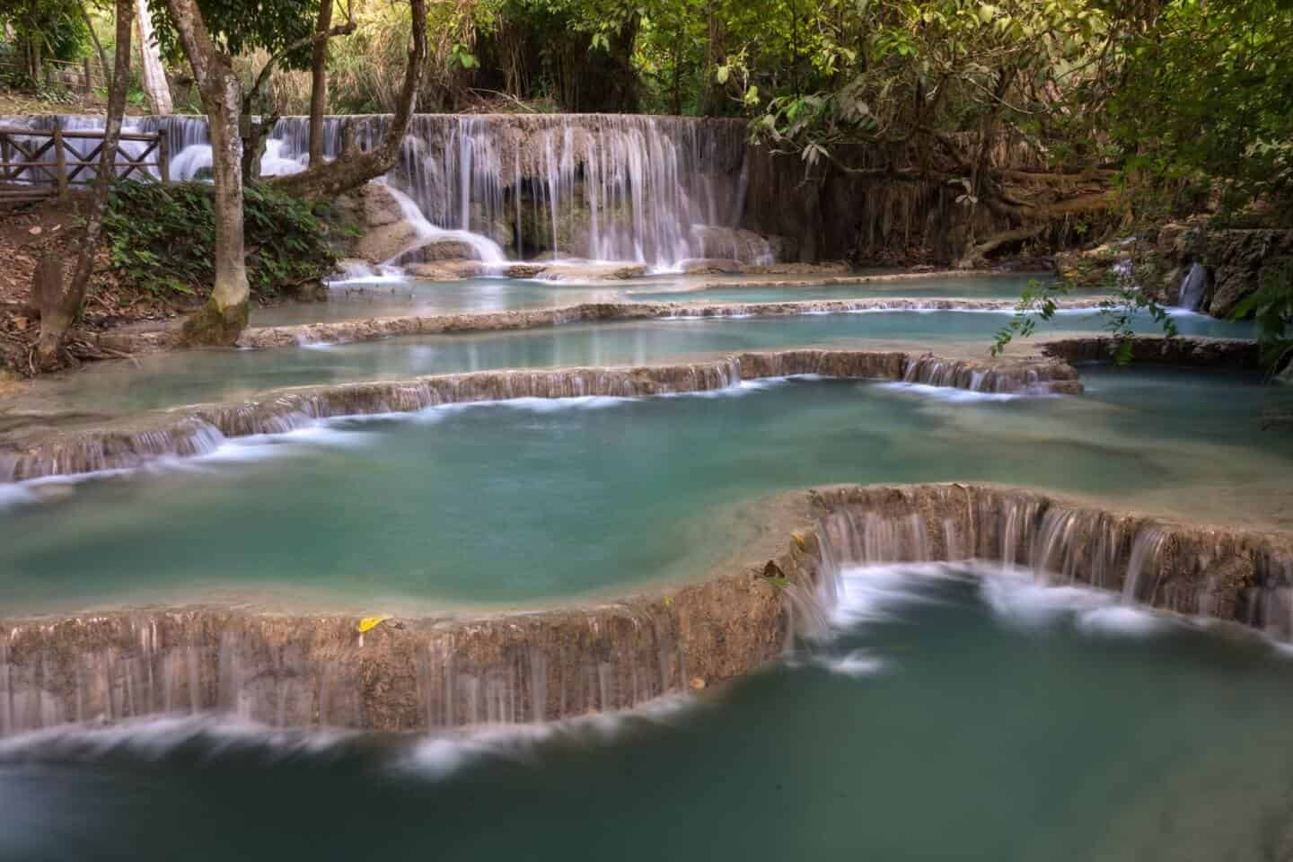 Cascading layers of rock create a staircase of natural beauty at the fourth tier of Kuang Si Falls.