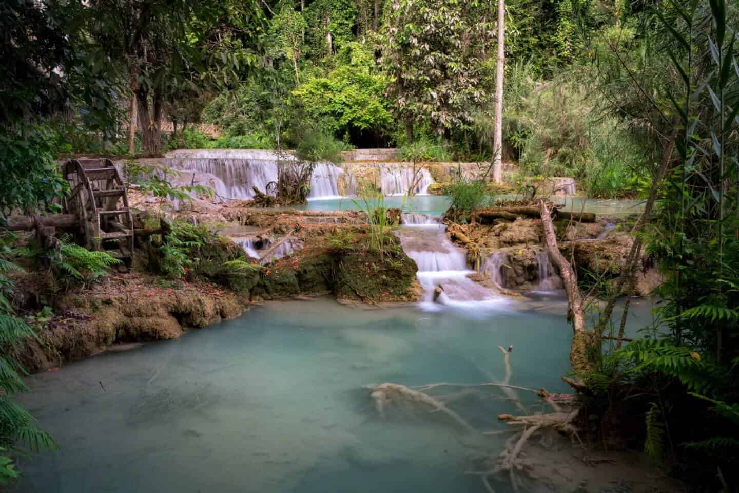 A small wooden mill adds a charming subject to this beautiful scene in Kuang Si Falls.