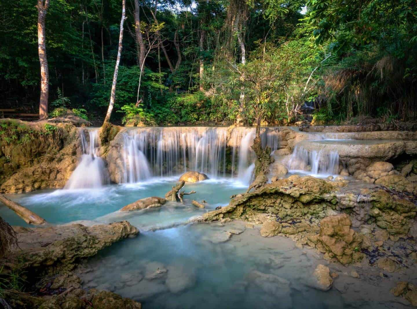Vibrant colours fill the scene at a small section of the lower Kuang Si Falls.