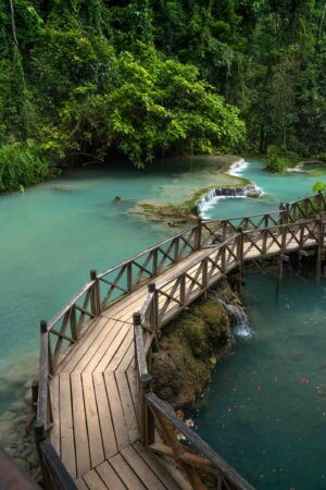 The wooden pathway at Kuang Si Falls adds a pop of colors, textures, and leading lines.
