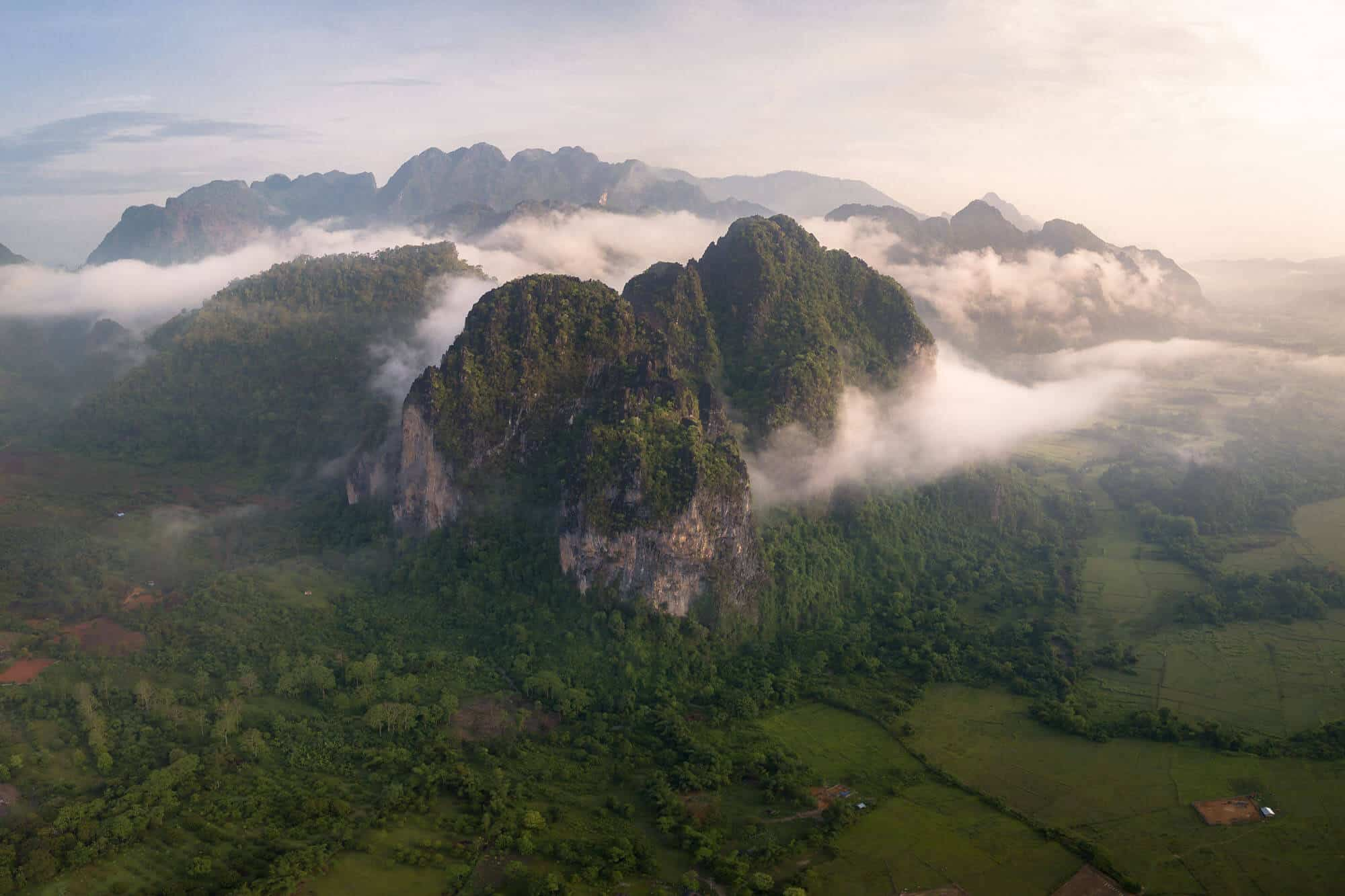 The mountains of Vang Vieng embraced by moody morning clouds