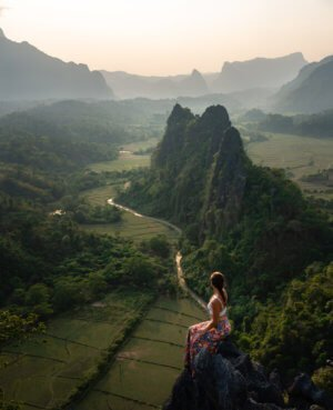 The view from Nam Xay Viewpoint Vang Vieng overlooking rice fields and mountains