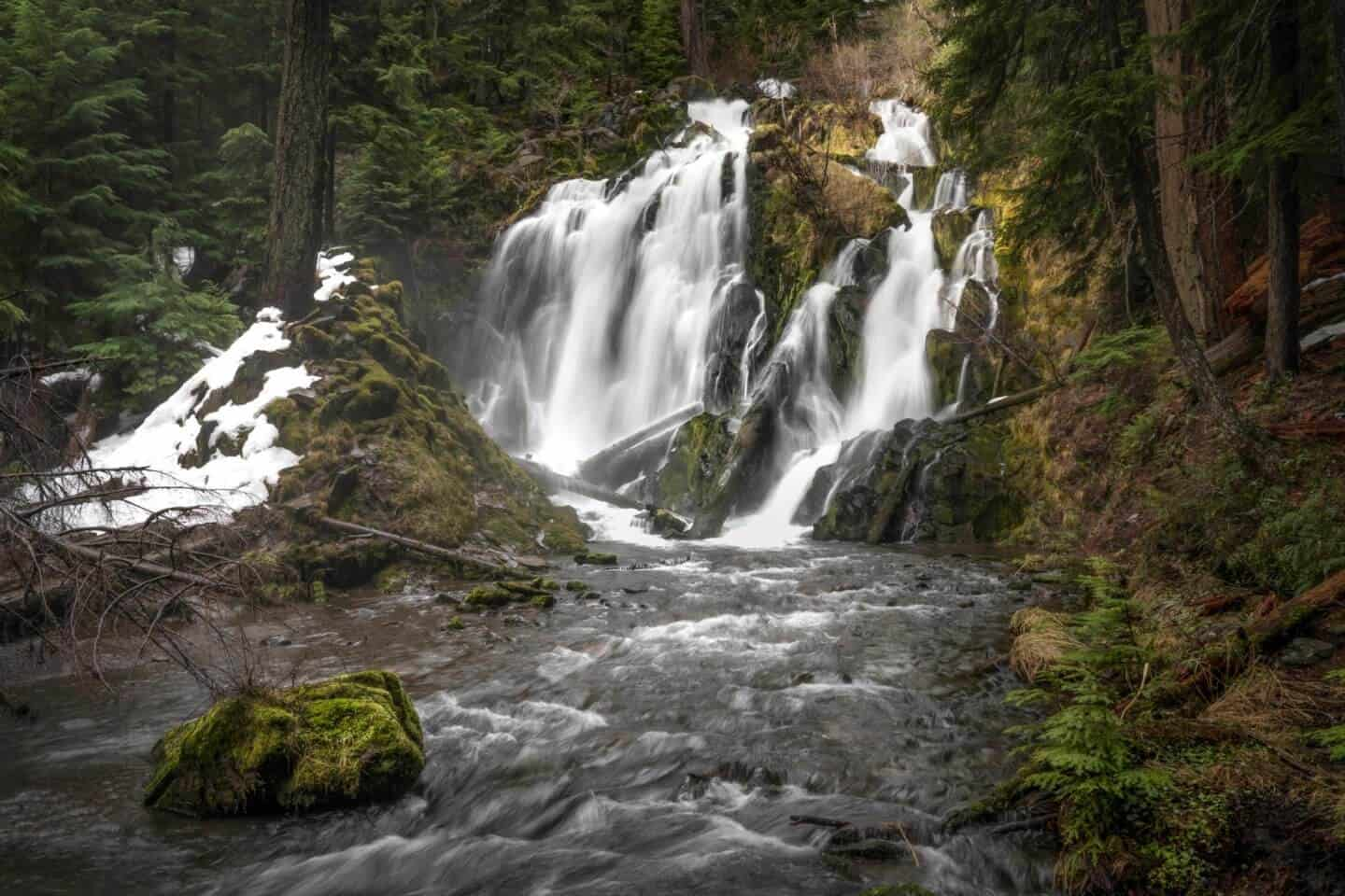 A moody day long-exposure photograph of National Creek Falls near Crater Lake, Oregon.