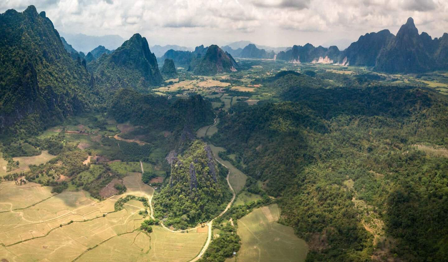 A drone photo from Vang Vieng capturing the dramatic mountains and landscape of northern Laos