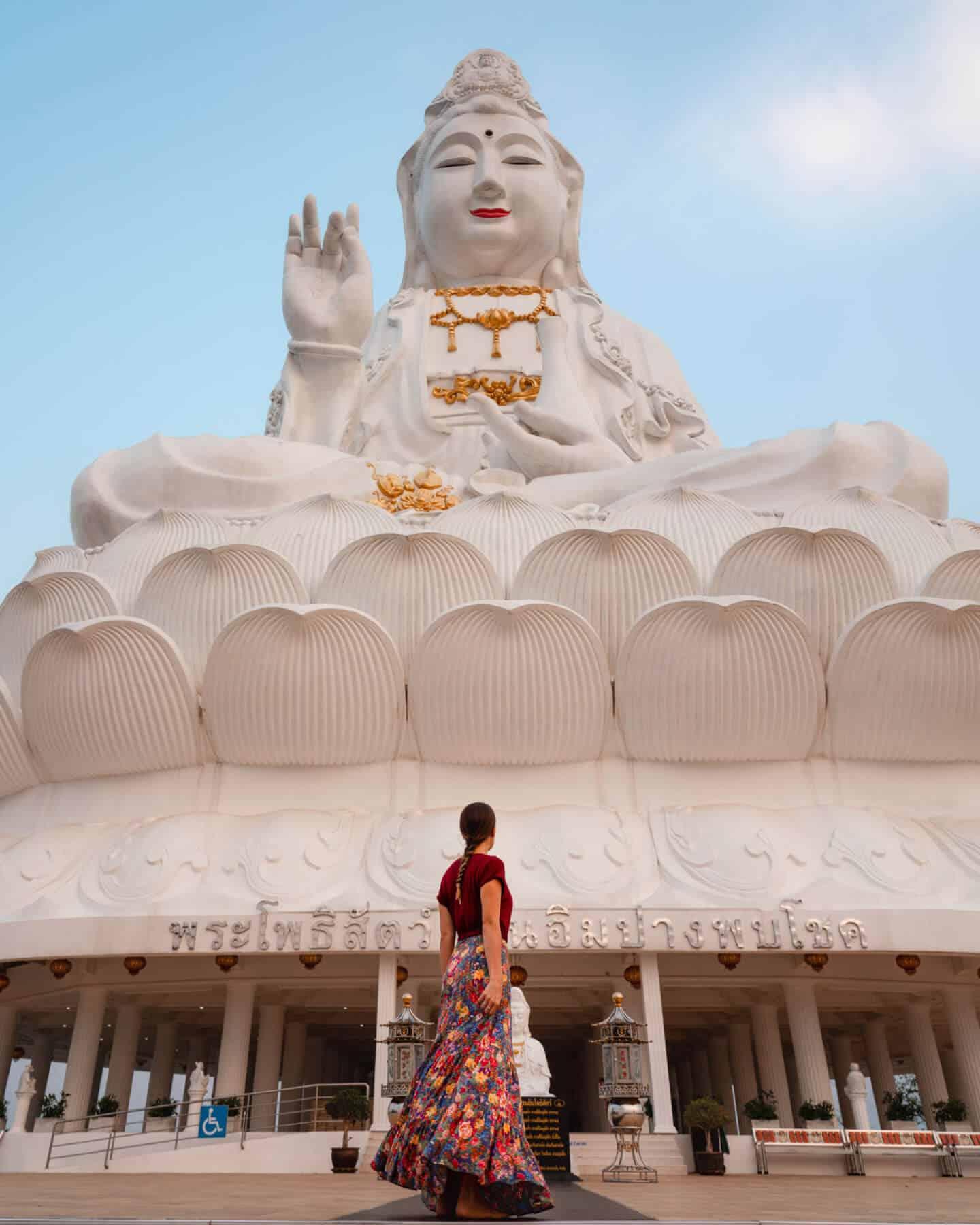 "Sophie gazes up at ""The Big Buddha"" statue of Wat Huay Pla Kang in Chiang Rai."