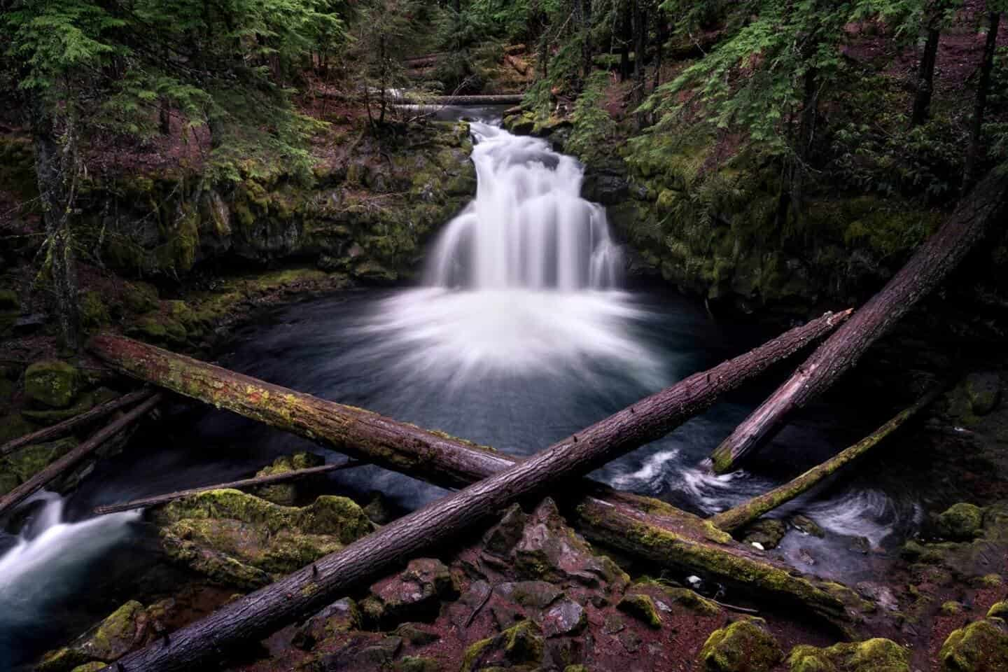 A landscape photograph of Whitehorse Falls in the spring.