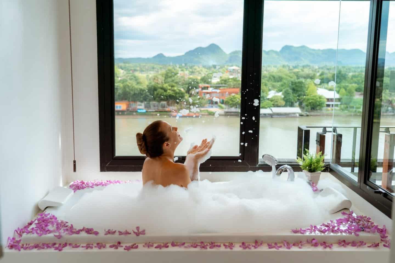 Enjoying the jacuzzi bath tub at Natee The Riverfront Hotel Kanchanaburi