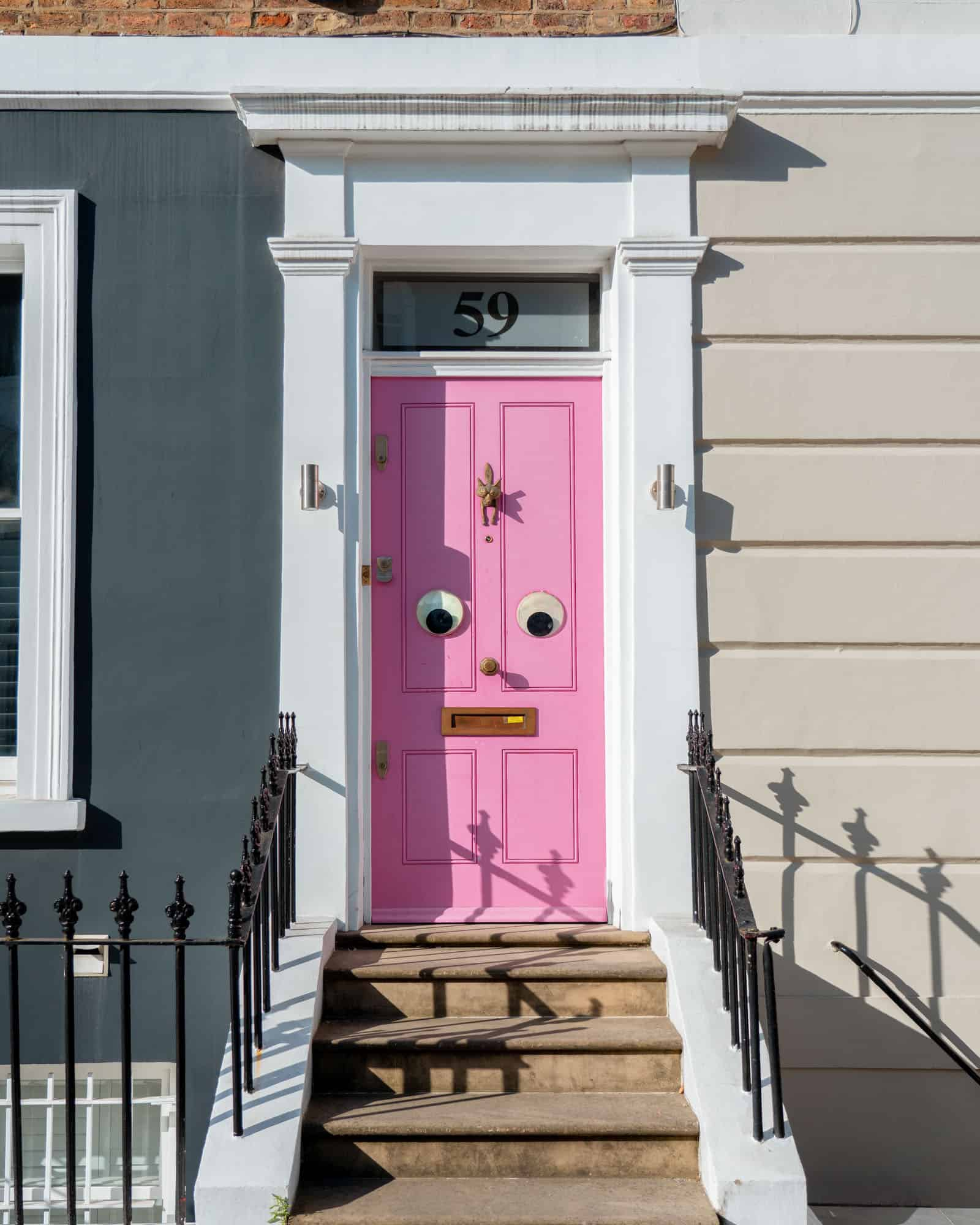 Insta-famous door with fun googly eyes at 59 Portland Road Notting Hill