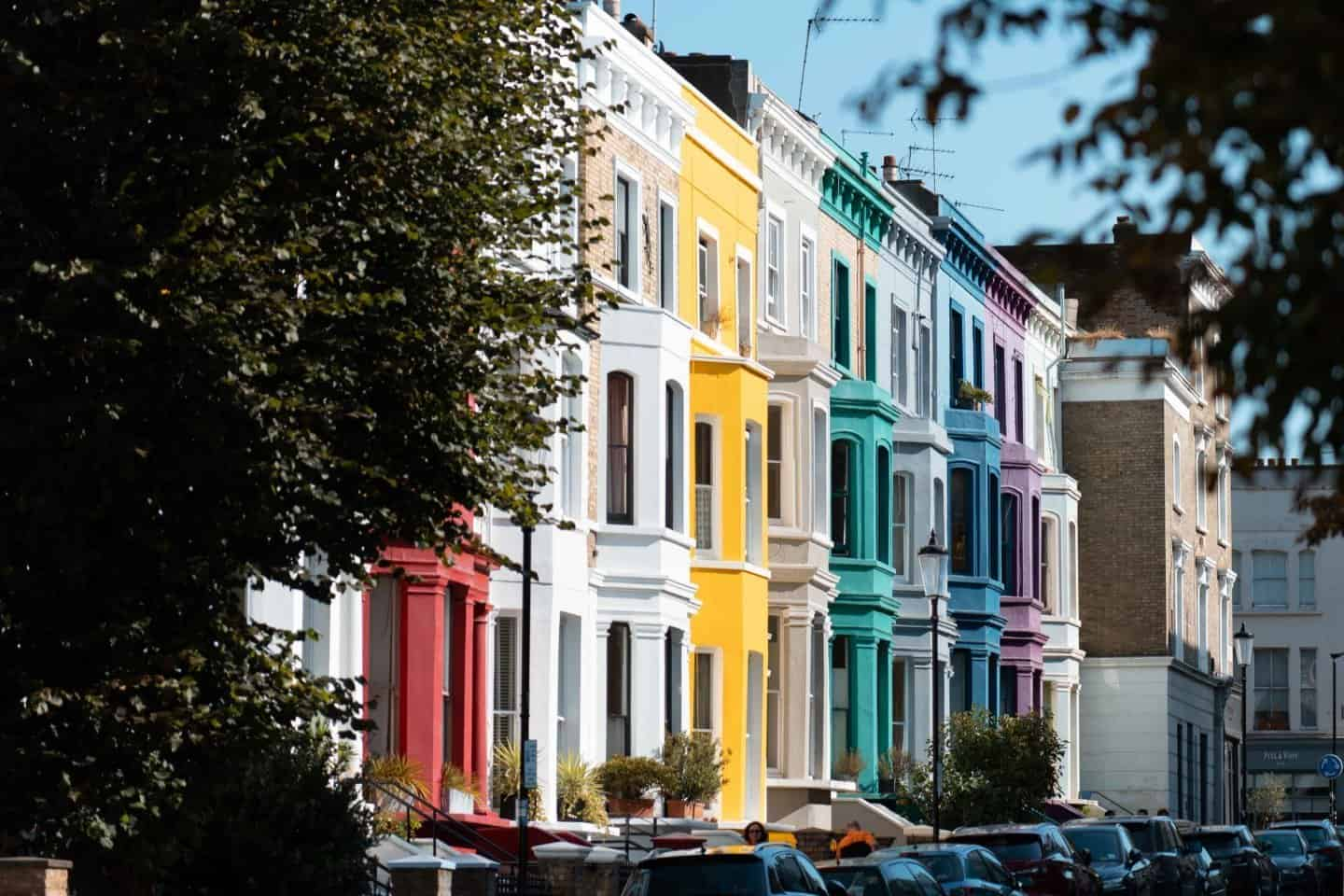 Rainbow coloured houses line Lancaster Road, Notting Hill