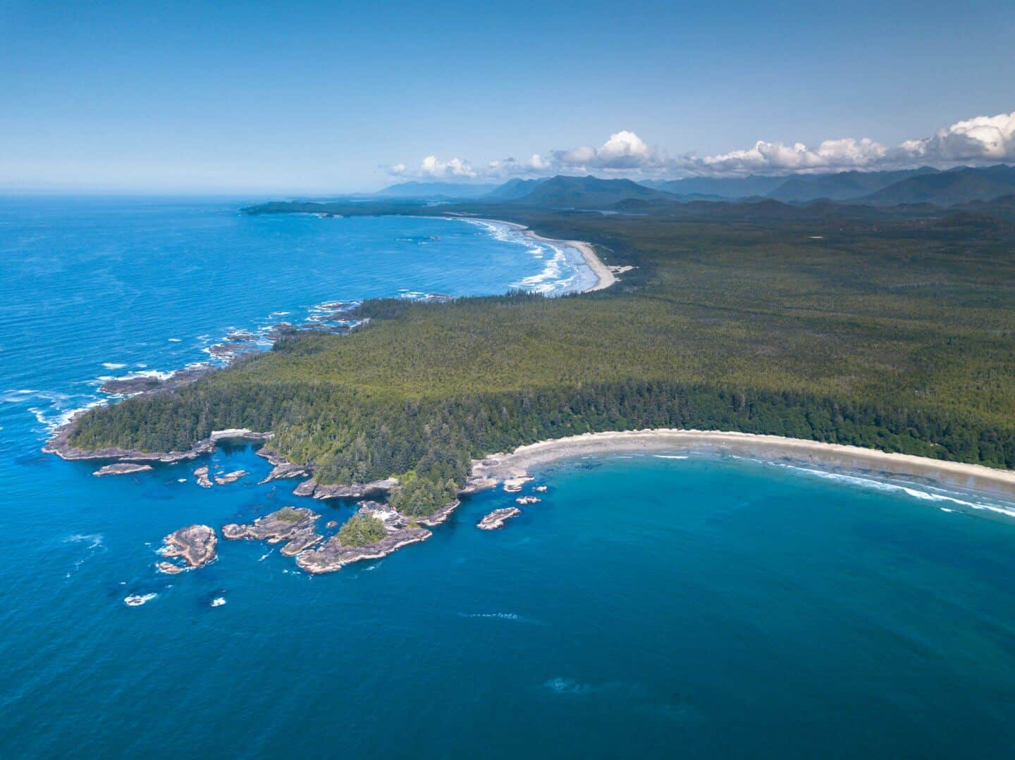 An aerial view of Long Beach and Combers Beach meeting outside of Tofino.