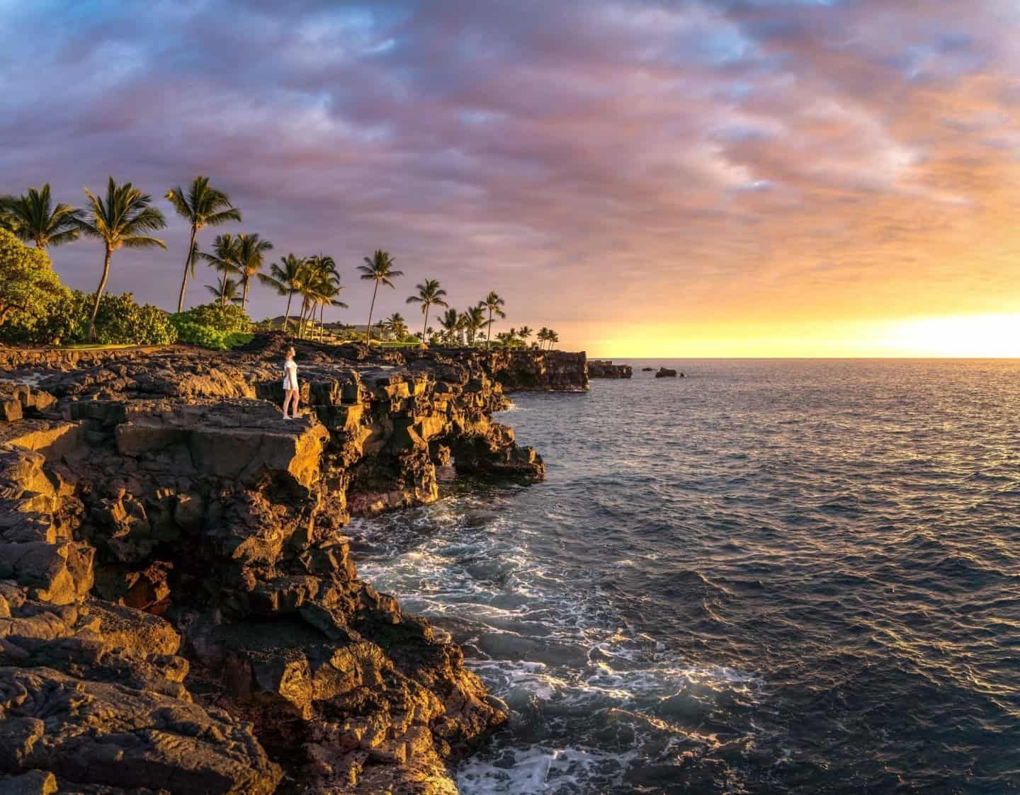 A beautiful big island photography location: Taking in a sky fire sunset from the sea cliffs near the Sheraton Kona on the Big Island Hawaii.