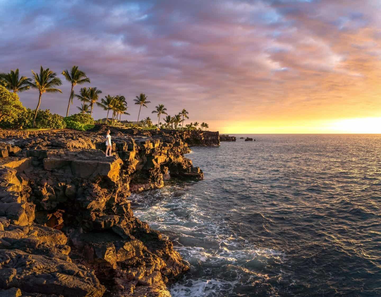 A beautiful big island photography location: Taking in a sky fire sunset from the sea cliffs near the Sheraton Kona on the Big Island Hawaii.
