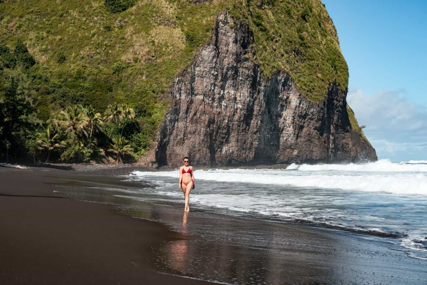 Big Island photography location: Sophie Clapton strolls along the black sand beach of the Waipio Valley.