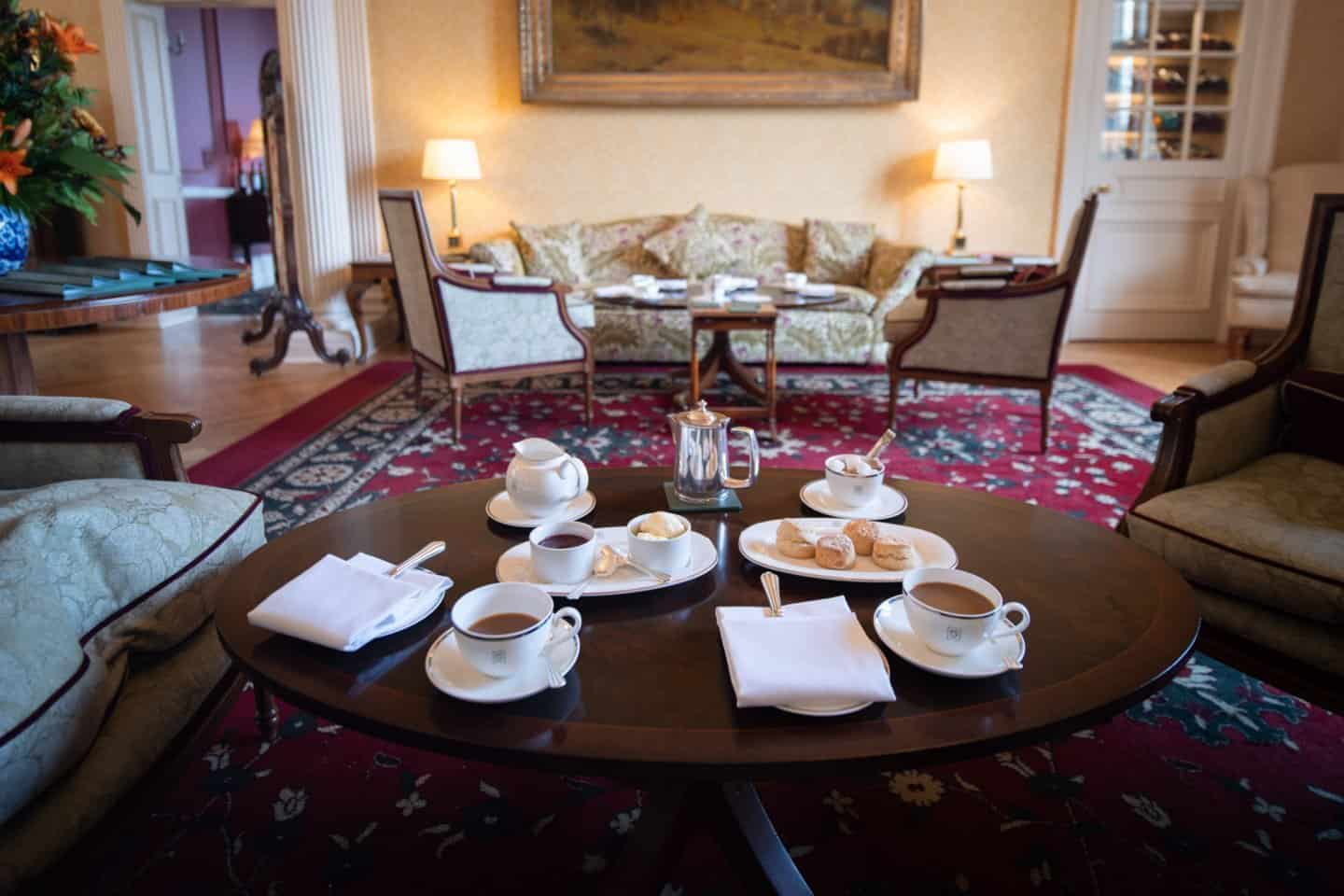 Cream tea in the warm, cozy drawing-room at Glenapp Castle