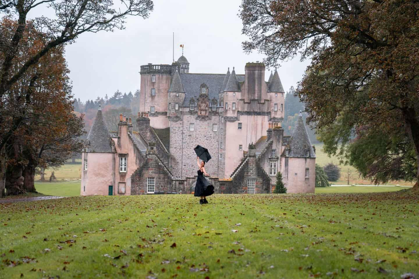 Dancing in the rain in front of Castle Fraser.