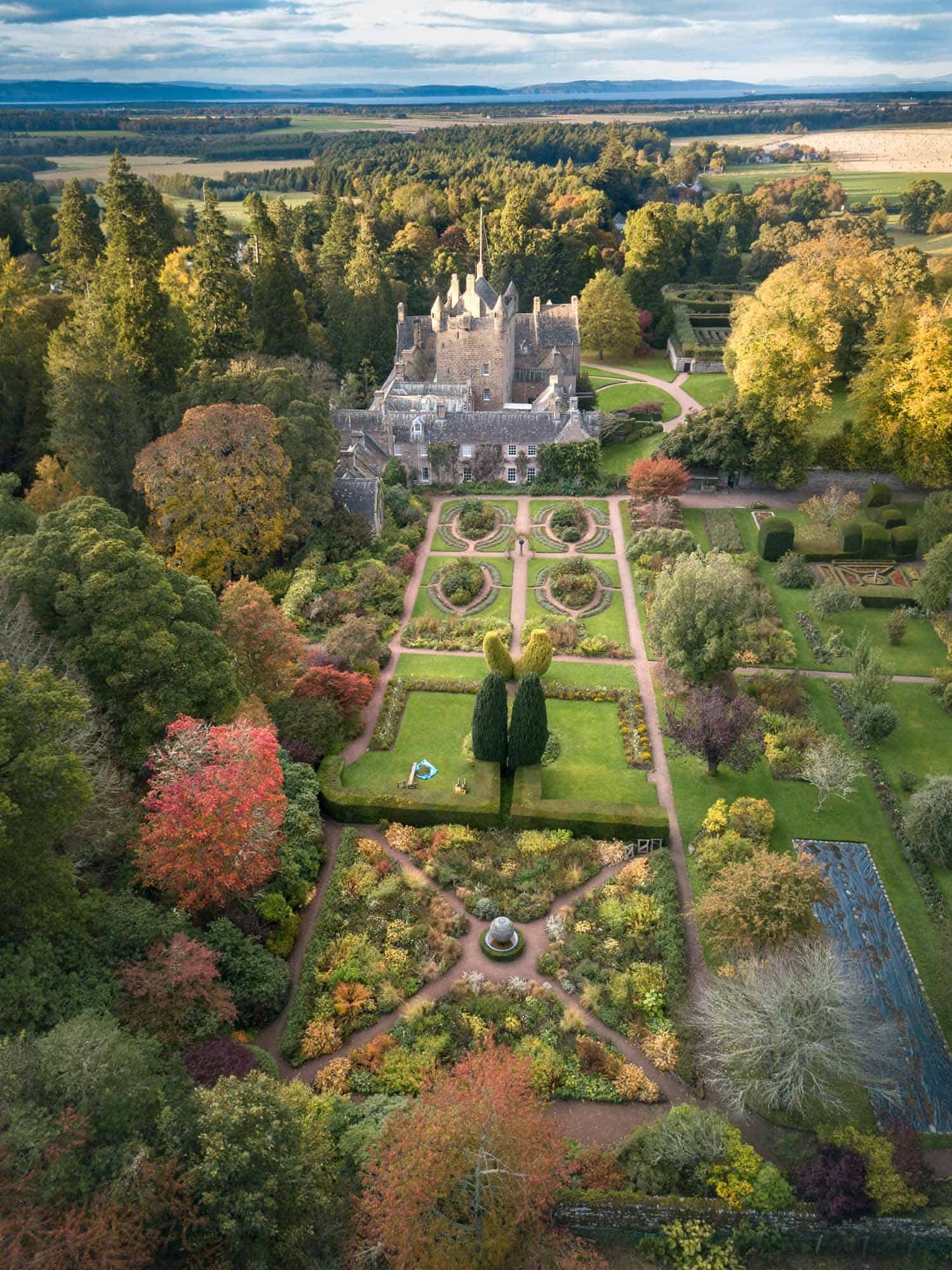 The impressive Cawdor Castle and gardens at golden hour.