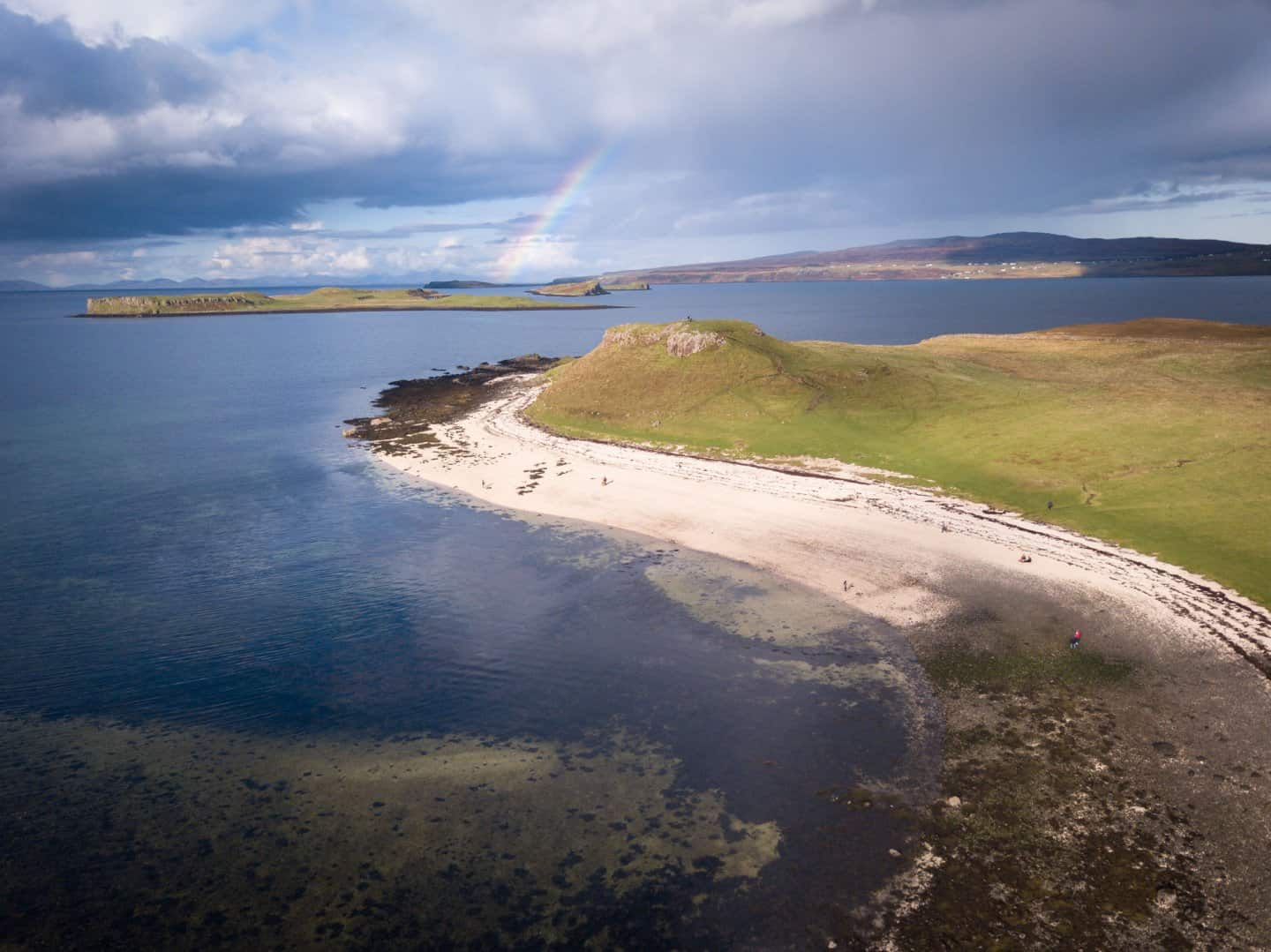 The only beach you will see during 10 days in Scotland is Coral beach, seen here with a rainbow.