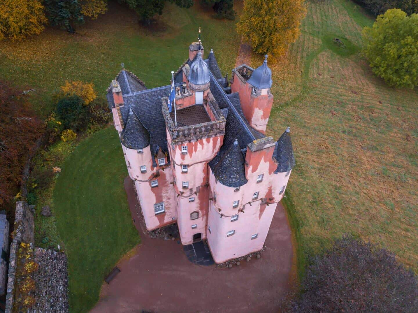 Looking down at the pink, Disney-like Craigievar Castle.