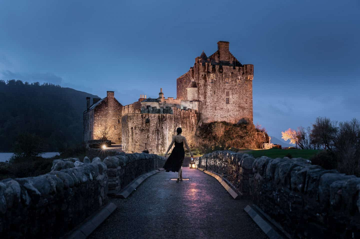 Sophie Clapton walks the bridge to Eilean Donan Castle after dark.