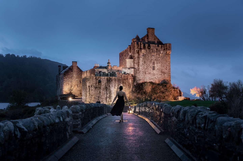 Sophie Clapton walks the bridge to Eilean Donan Castle after dark.