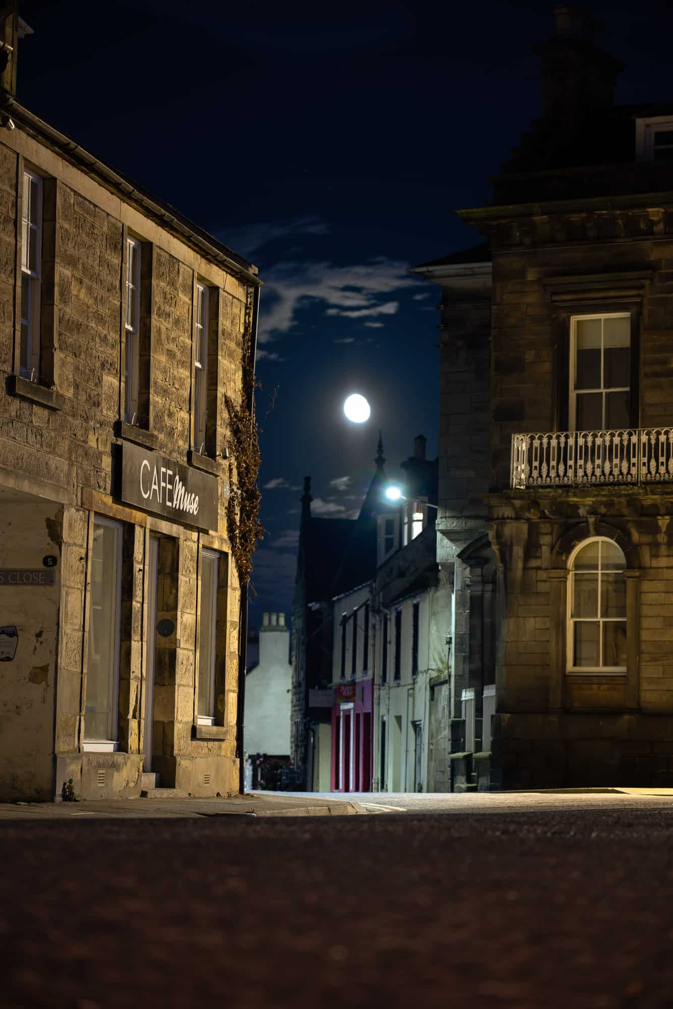 10 days in Scotland means 10 nights as well. A nearly-full moon lights up the city of Elgin at night.