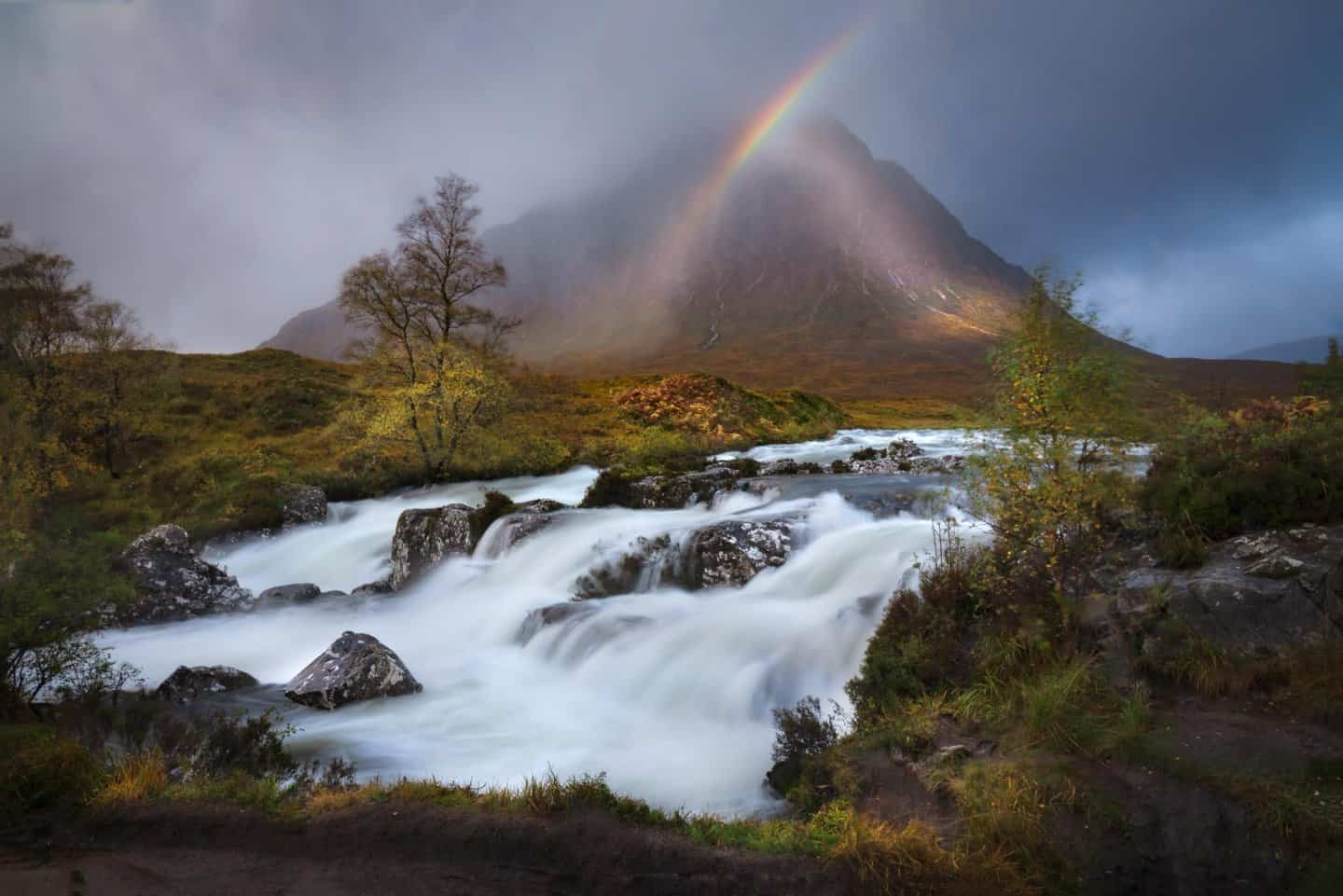 A sudden rainbow bursts out over Etive Mor Waterfall near Glencoe.