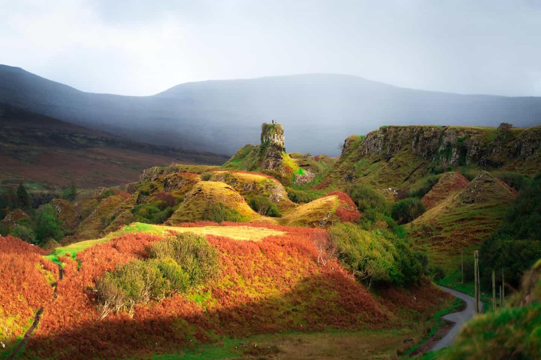 Castle Ewan basks in golden hour light in the Fairy Glen.