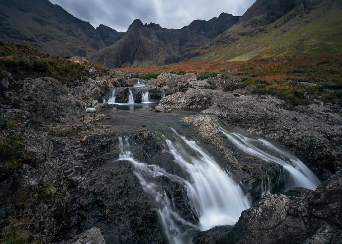 Water cascades through the Fairy Pools on Isle of Skye.