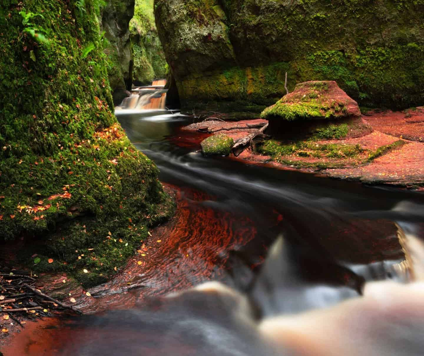 Blood red waters run through the Devils Pulpit at Finnich Glen.