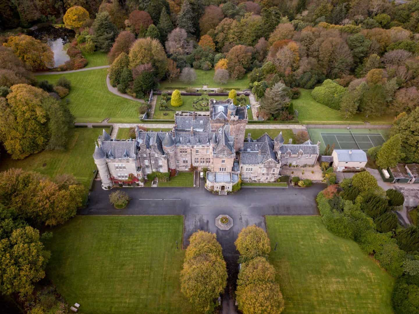 Best castles in Scotland: A drone photo of Glenapp Castle in Scotland.