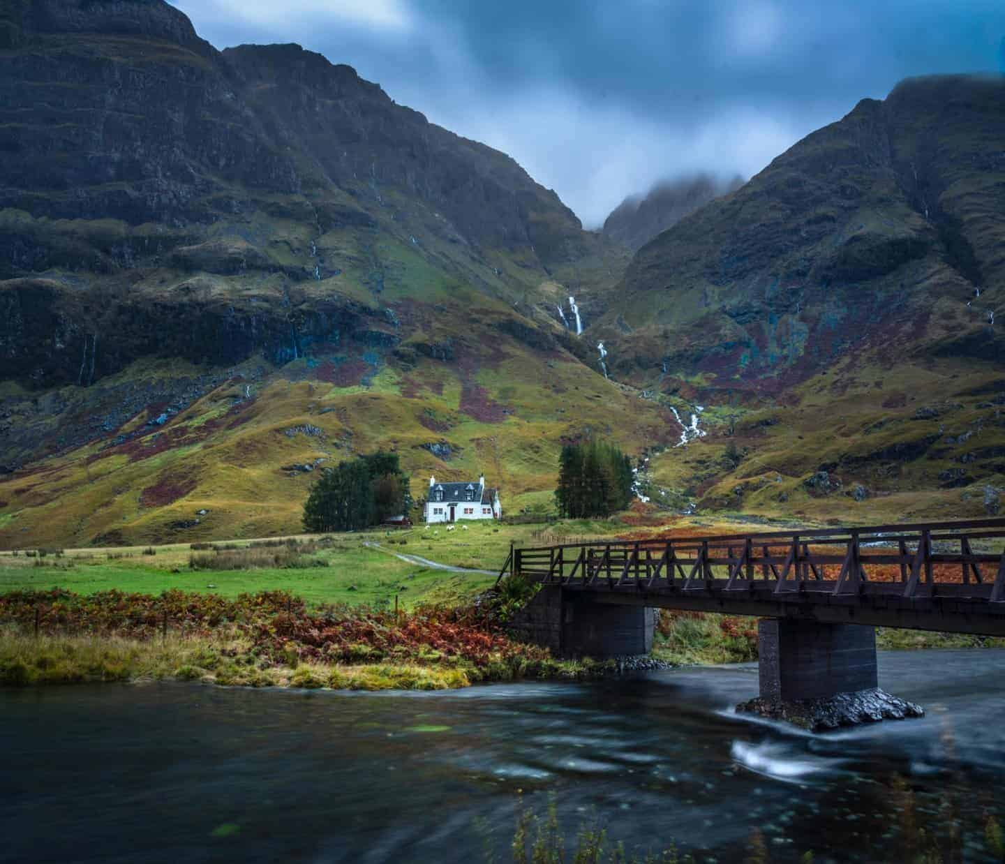 A quaint Scottish house in the Highlands on a moody Glencoe day.