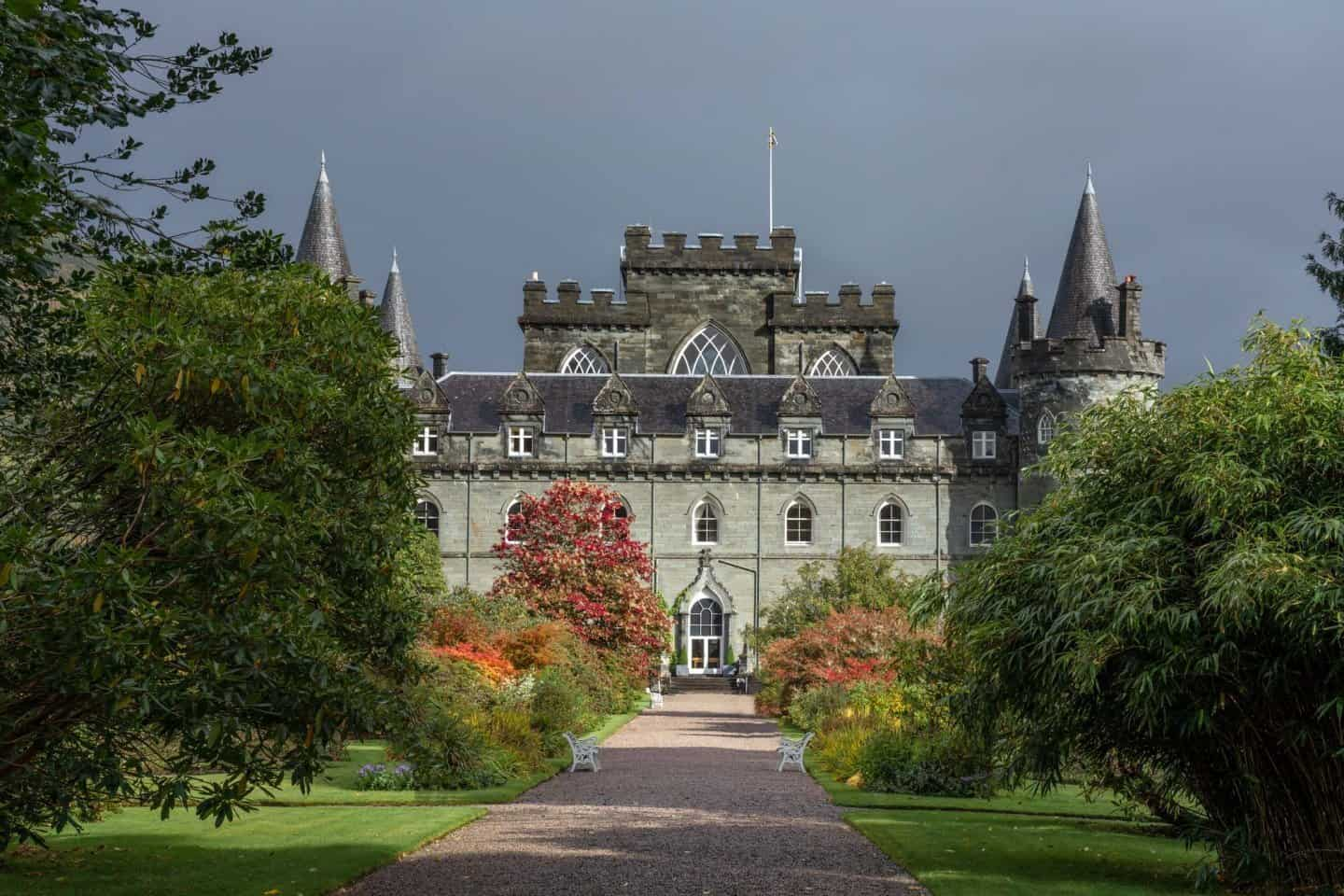 Top 20 castles in Scotland: Viewing Inveraray Castle and garden through the gate on the way to the castle.