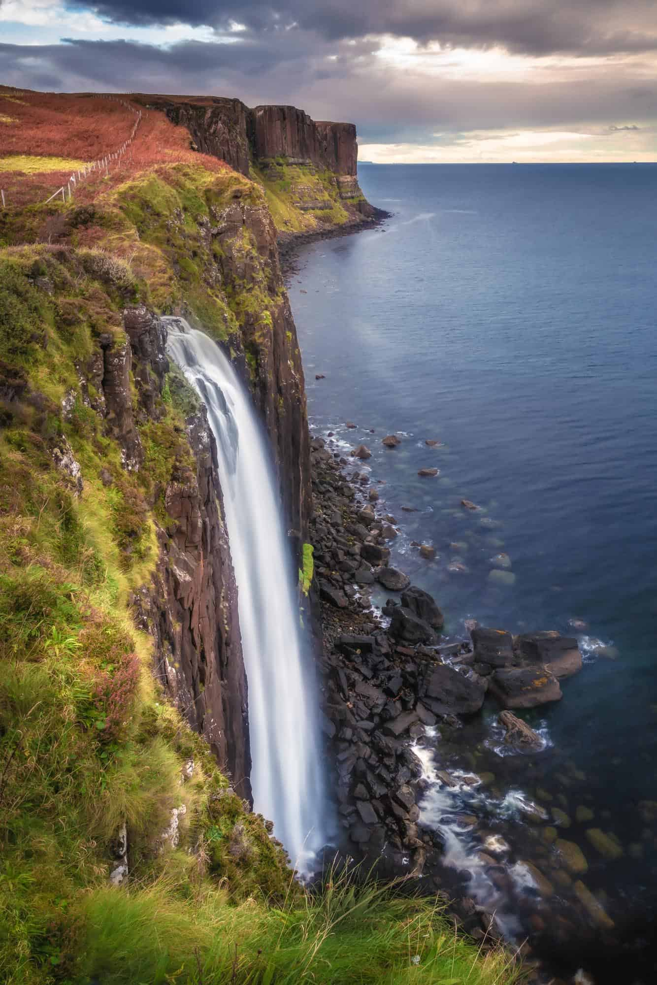 The view of Mealt Falls at Kilt Rock during golden hour on the Isle of Skye.