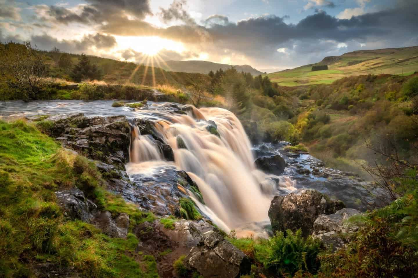 A magical sunset at the Loup of Fintry in Scotland.