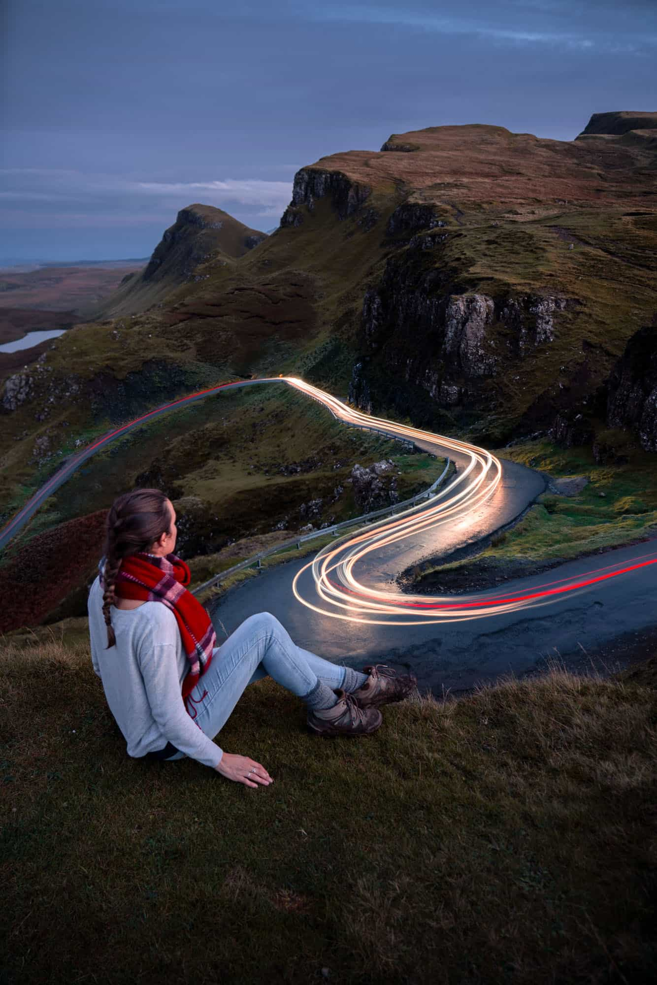 Watching cars drive by high above Quiraing on a 10 days in Scotland road trip.