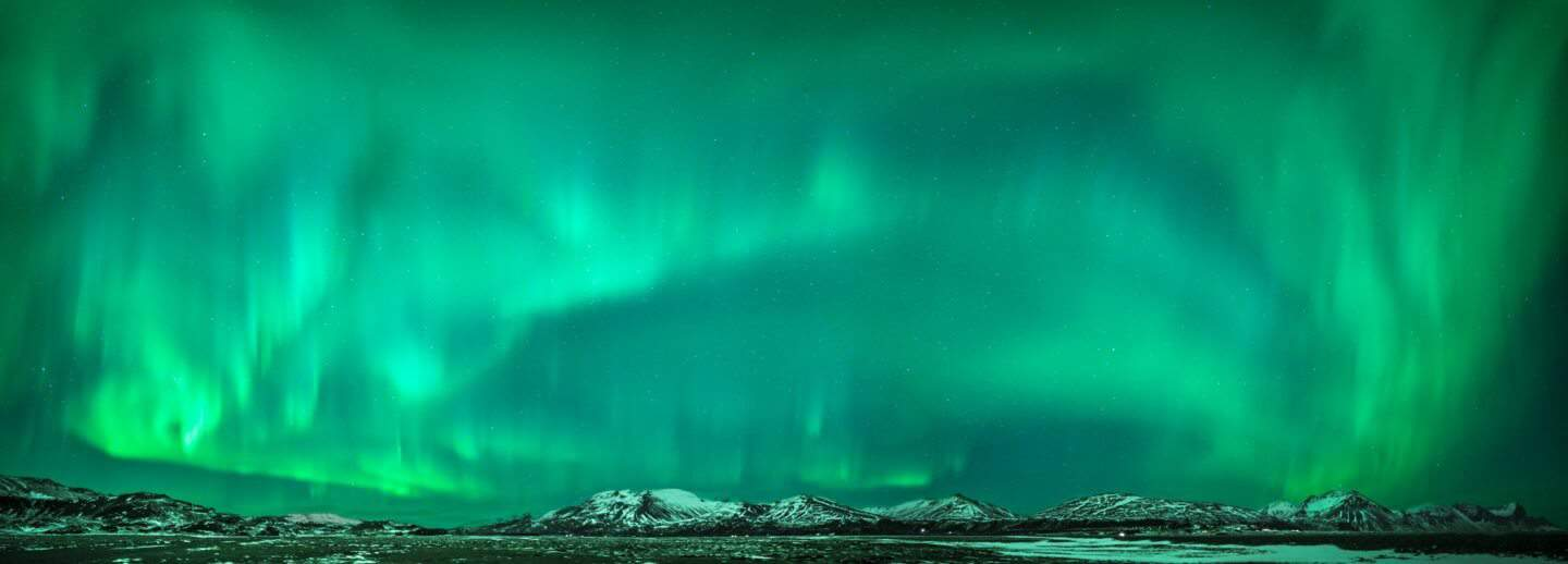 Panorama aurora photography showcasing the amazing night sky in Southeast Iceland.