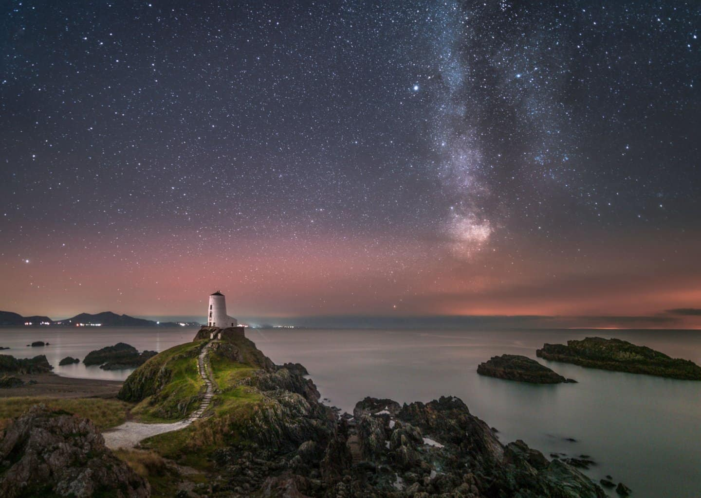 The Llandwyn Island Lighthouse is one of the best places for night photography near Snowdonia.