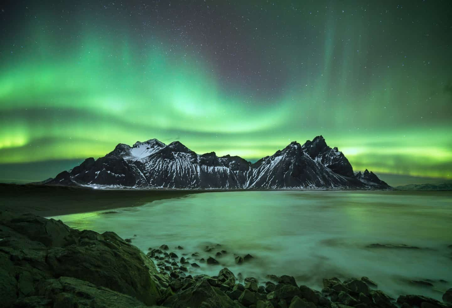 Photographing aurora at Vestrahorn on an Iceland winter night.