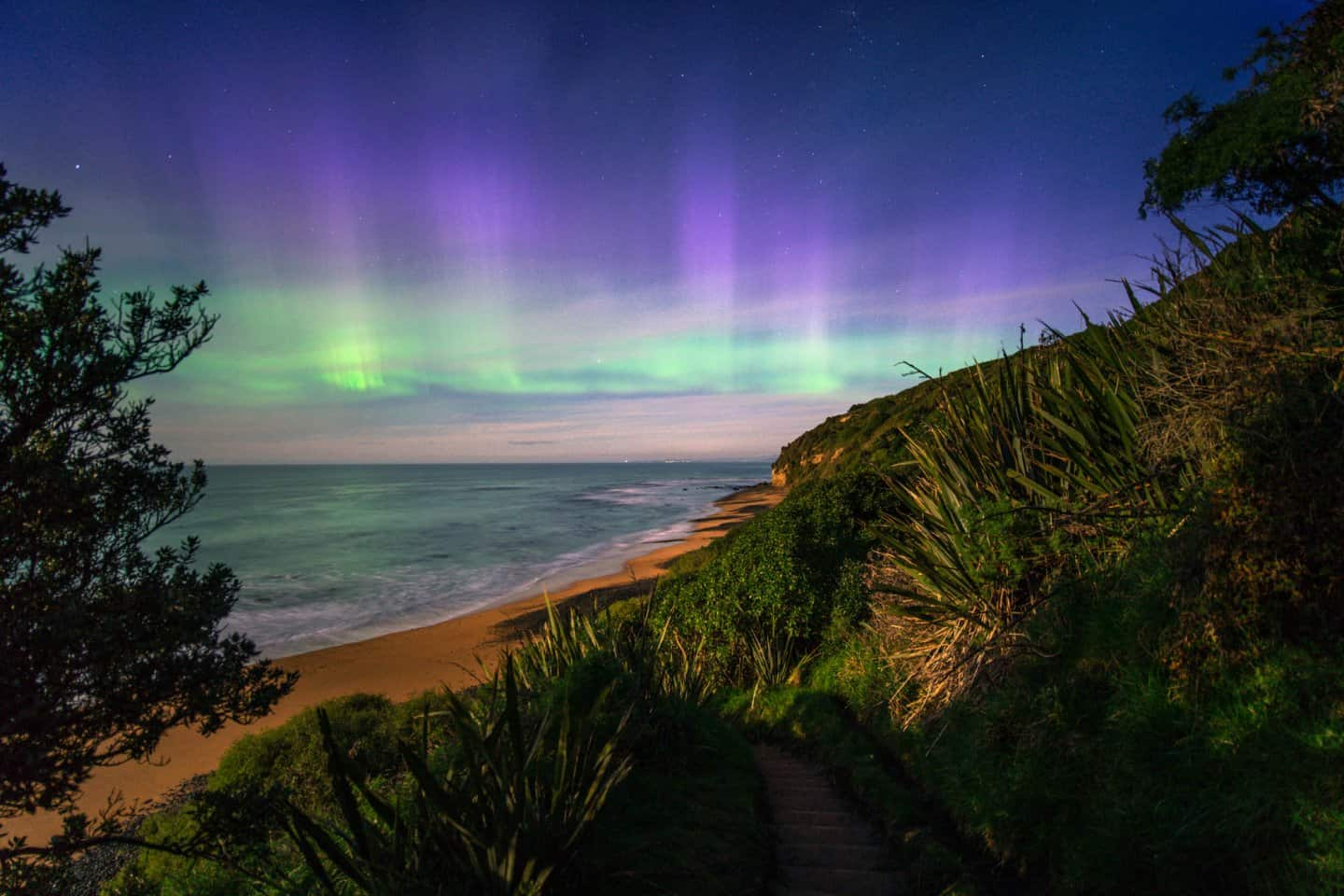 Aurora Australis Photography taken on a beach in New Zealand
