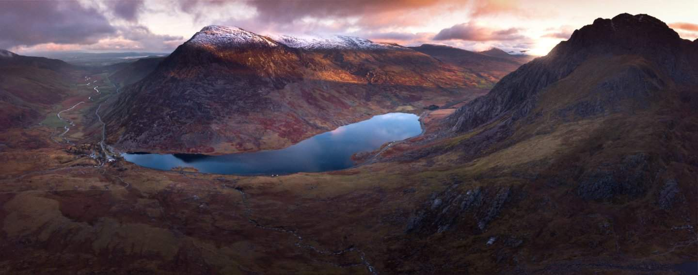Snowdonia photography of Ogwen Valley from the sky is breathtaking at sunrise.