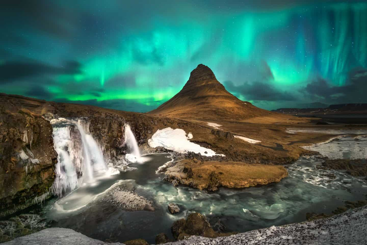 Aurora photography at Kirkjufellsfoss in Iceland.