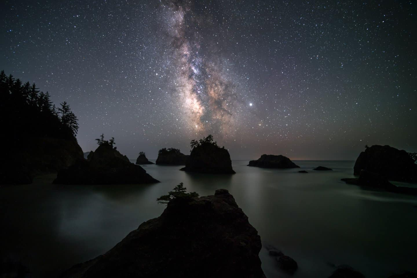 A Milky Way image of Secret Beach, one of the most popular astrophotography locations for Southern Oregon Coast photography at night.