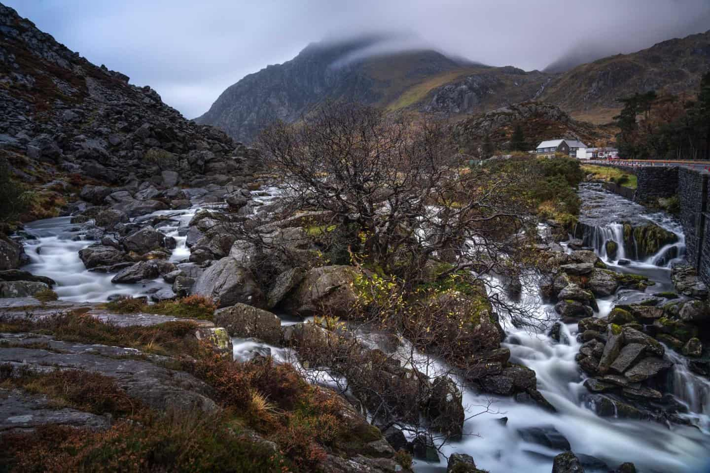 Water cascades from Llyn Ogwen as Tryfan broods moodily in the background.